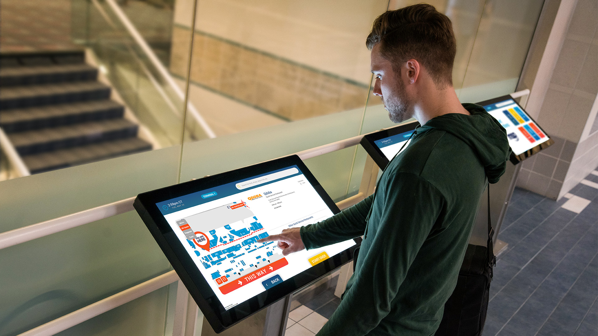 Close up of A guy using the interactive wayfinding kiosks at the MSP Airport