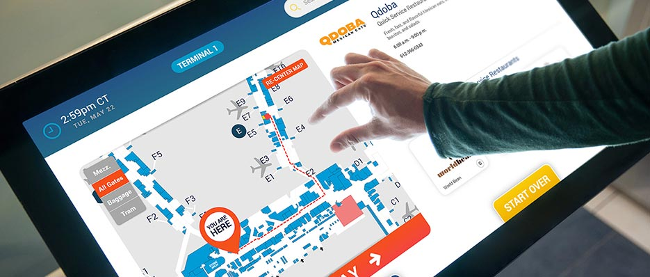 Shopper using wayfinding map.